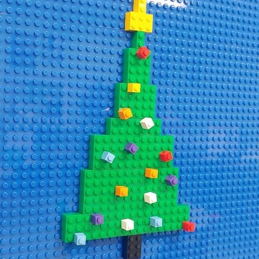 Not only do I see a wide range of creativity and skill here at the LEGO® Wall, it's also a great place for guests to express their holiday cheer...which makes me happy.
