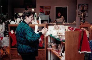 A shopper browses holiday items in Seasons.