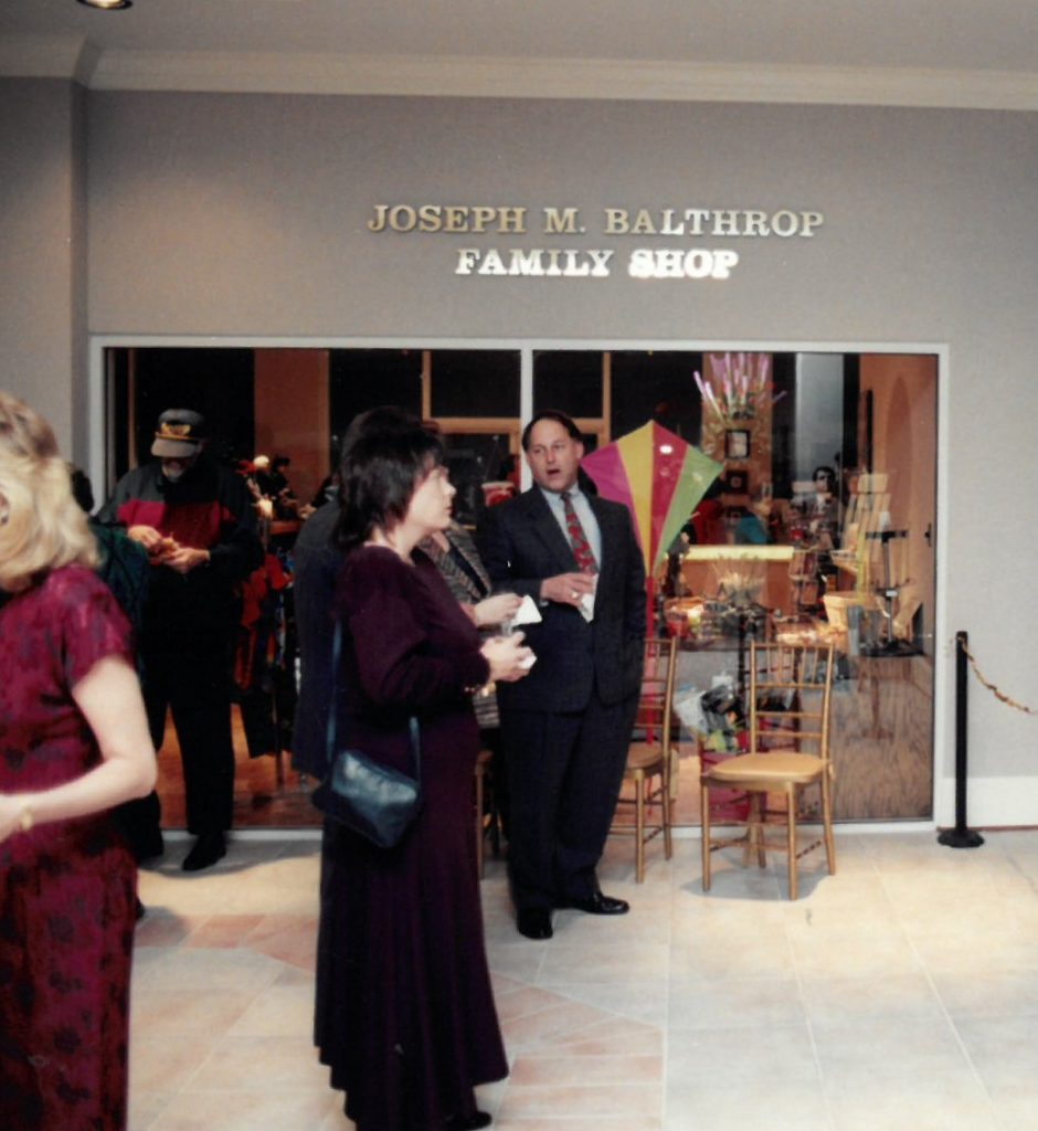 Opening reception of the 1996 building opening. Visitors stand in the Museum lobby outside the Joseph M. Balthrop Family Shop.
