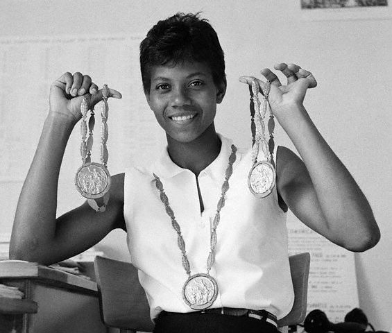 Wilma Rudolph poses with her three gold medals