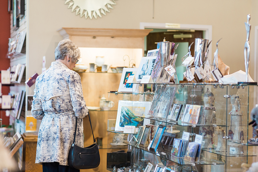 Shopper browses items in Seasons: The Museum Store.