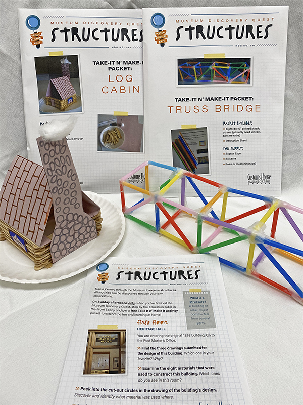 Product photo of 'Structures' Museum Discovery Quest pamphlet, activity packets and completed log cabin and truss bridge.