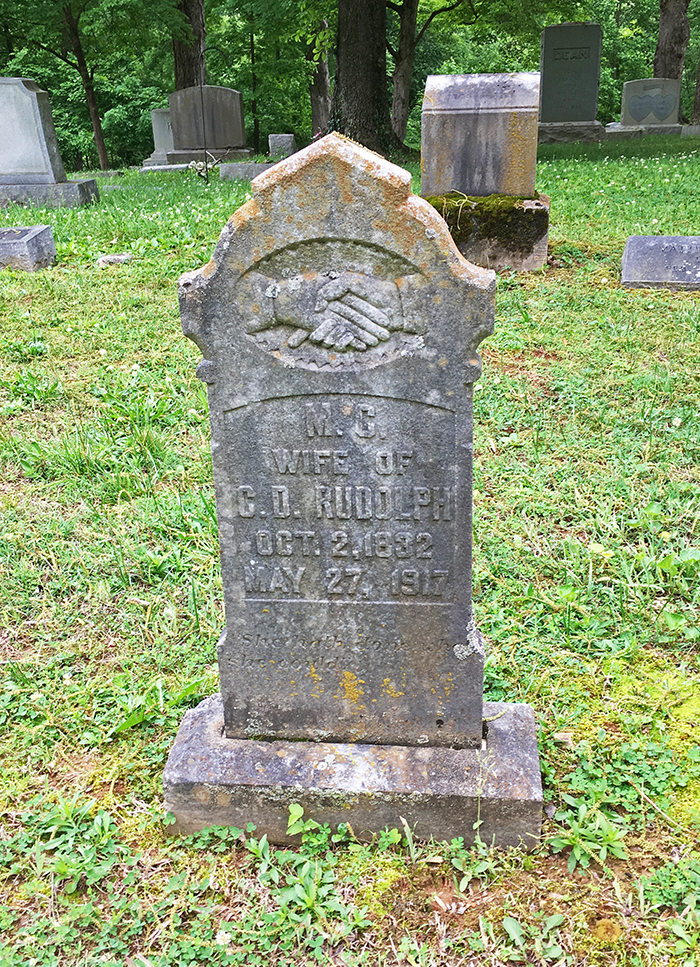 Headstone at Greenwood Cemetery reads M.C. Wife of C.D. Rudolph, Oct. 2, 1832 - May 27, 1917.