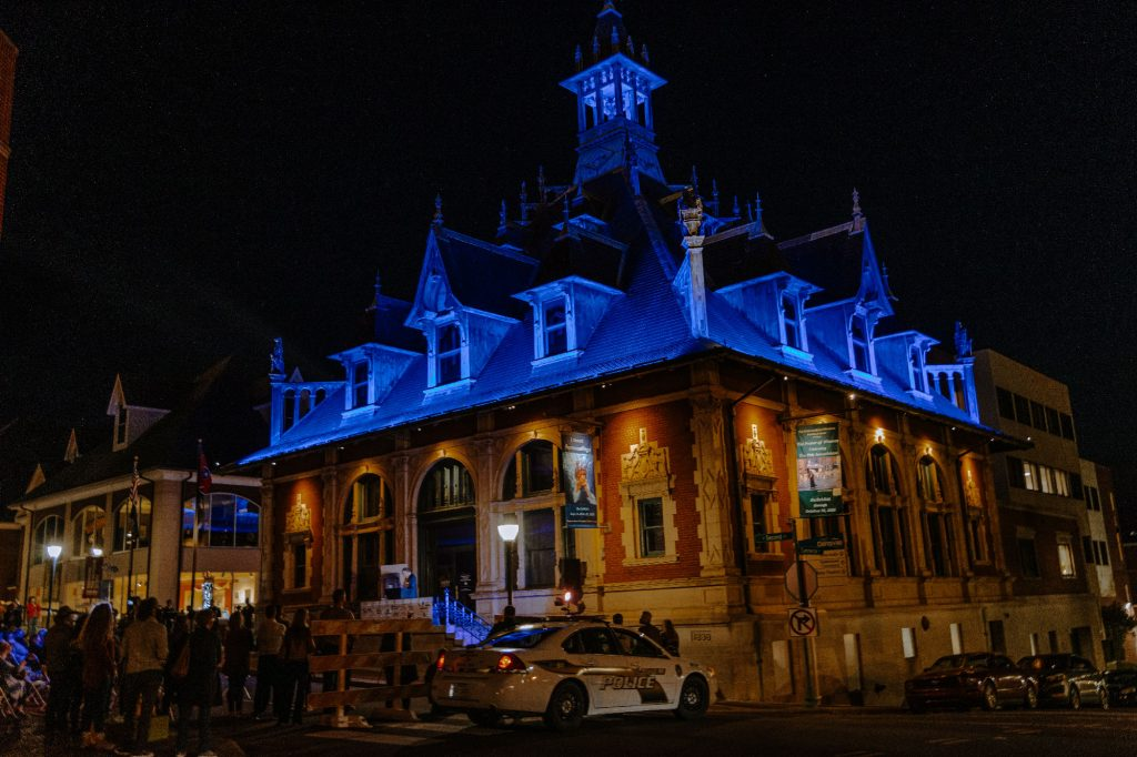 The Customs House Museum & Cultural Center illuminated in blue for the crowd.