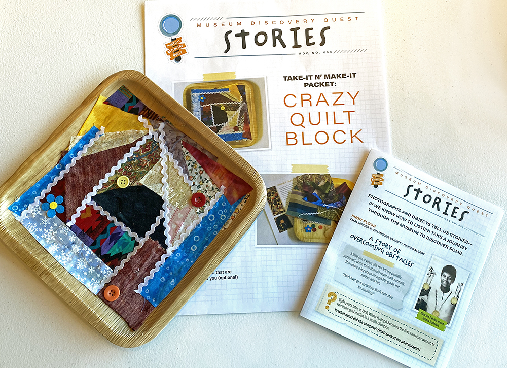 Product photo of 'Stories' Museum Discovery Quest pamphlet, activity packet and completed crazy quilt block.