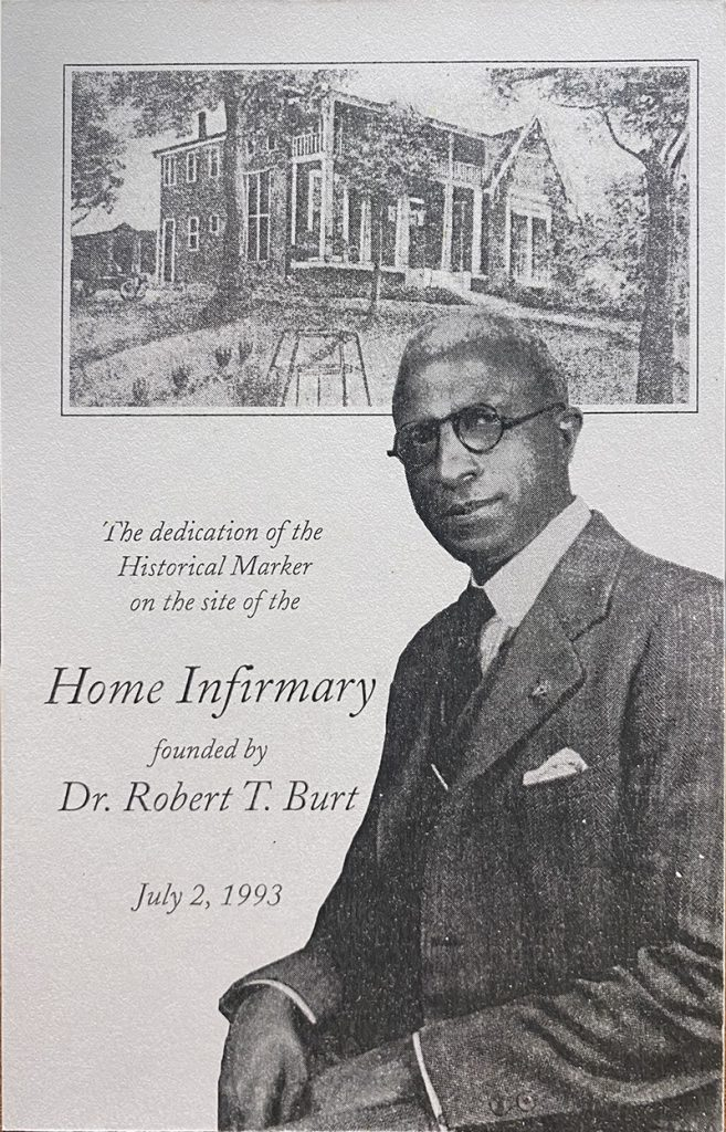 "Black and white photo of Dr. Burt and the home infirmary. Text reads ""The dedication of the historical marker on the site of the home infirmary founded by Dr. Robert T. Burt; July 2, 1993"""