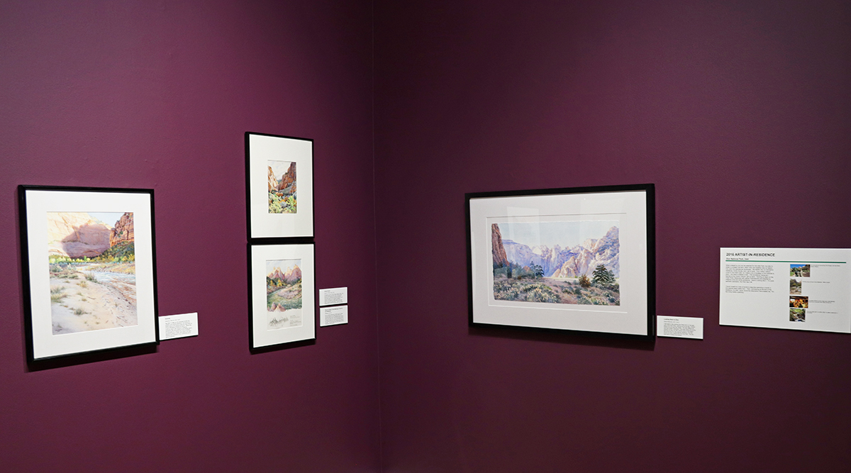 Four paintings displayed in Larry Hughes' exhibit.